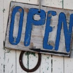 Photo: Open Sign with blue lettering